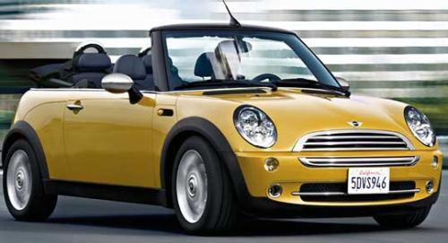 mini cooper- convertible - i would love to have one someday. i love the style of mini cooper's :)  i want mine in this color or in red :D