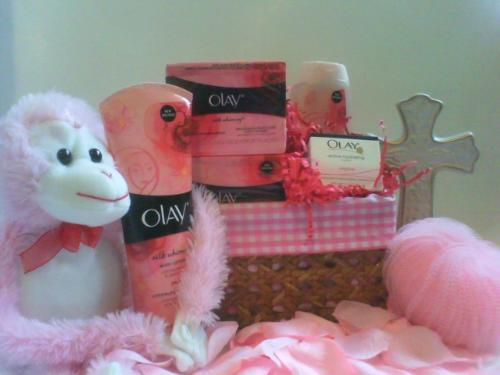 I create giftbaskets and gifts - This photo that you see is one of the giftbaskets that I created. It was for mothers day. Its theme is pink and it s called ' Olay for mothers day'. It's filled with olay products. I can create all types of giftbaskets so to=une in to more pictures and you can also visit my website at www.onegifttogive.devhub.com. You will also see an email address there and business number. Perfect for placing orders . Thanks for your support.