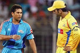 Sachin & Dhoni - Sachin & Dhoni having a good time on the field.