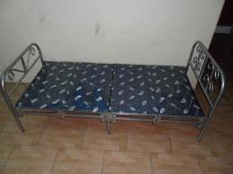 Folding bed - beds have nylon sheets in the middle held by springs on it sides that is attached to steel bars that folds in the middle for easy storage