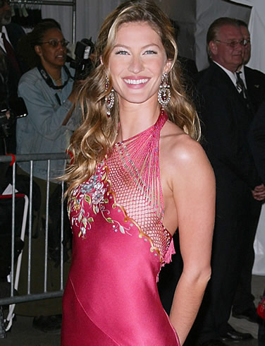 Gisele Bunchen - Revealing dress on the left boob! Gisele was being daring!