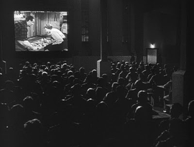Black and White Theater - A black and white photo of people in a movie theater.