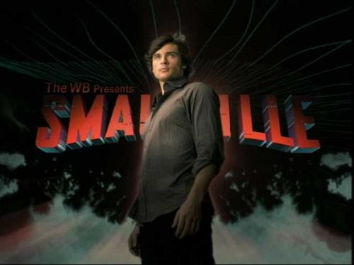 Smallville Poster - Clark Kent (Tom Welling) standing in front of the title Smallville.