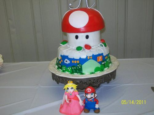 Wedding cake - My cousin Amanda(Rue) Atkins Hamilton and her husband Travis Hamilton's Mario wedding cake. Isn't it soooo cute?