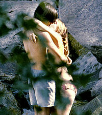 Kissing couple - A young coulpe kissing.
