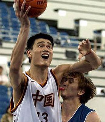 Yao Ming - Check the guy out trying to block Yao! His tongue is sticking out and licked Yao's armpit! it is gross and funny!