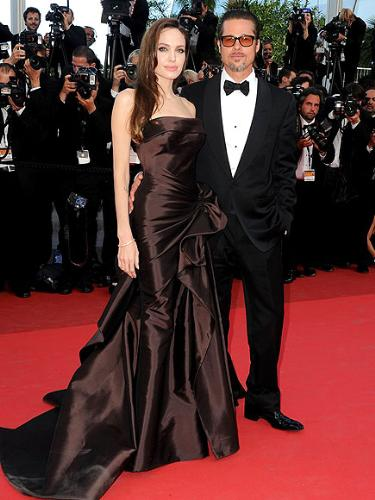 Angie and Brad - They are at the Cannes Film Festival. What a hot couple! Both look awesome!