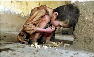 Poverty - A child is eating bad foods at the street