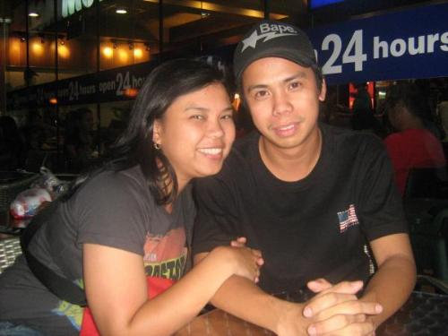 me n my honey - this pic was taken a year ago in MOA, me and my wife watch a concert called the 'FINAL SET' of ERASERHEADS. It's a great night watching my favorite band played their last concert.
