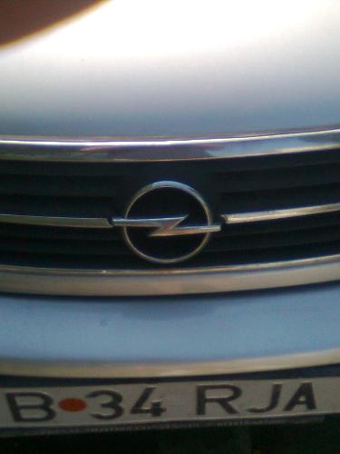 Opel Emblem - Here is the emblem of the Opel Brand on a car in my hood.