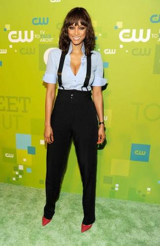 Tyra Banks - Trya's outfit reminds me of the Amish! She looks like she is ready to out in the field and do some field work! Yikes!