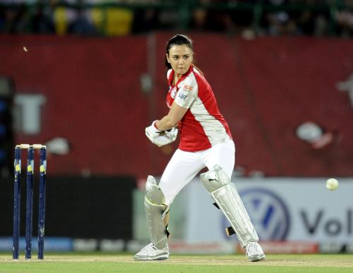 Zinta - Preity Zinta winds up for a big shot.