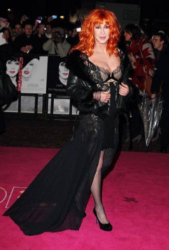 Cher - Cher at a movie premier in a red wig and a great dress!