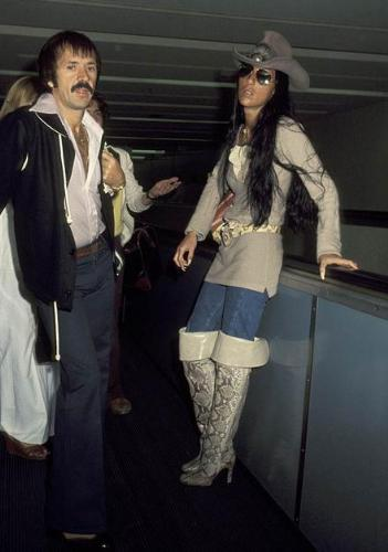 Sonny and Cher - This time this phot was taken when they were waiting for a flight at an airport.