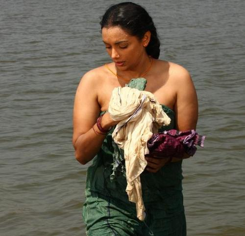 Beauty emerging after bath - Beauty covering her boobs after finishing her bath in a river