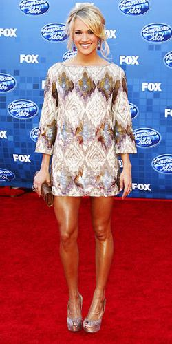 Carrie Underwood - She looks sassy and cute in the mimi dress! One thing is wrong though! Her legs look way to dark and I don't think she is wearing nylons! The legs and the rest of her skin don't match! Yikes!