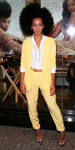 Solange Knowles - Beyonce's little sister. The pant suit isn't bad. Solange's afro is to much! No good!