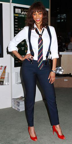 Tyra Banks - What is with the suspender and tie? It looks stupid! Tyra has no fashion sense lately!