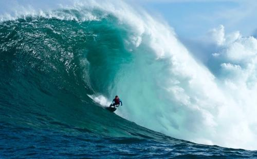 Catching a wave - A surfer on a huge wave!