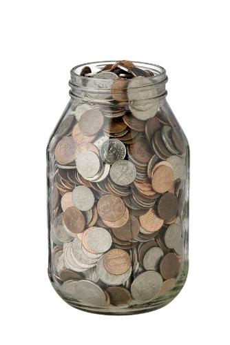Coin jar - Here is a coin jar. It has lots of coins in it.