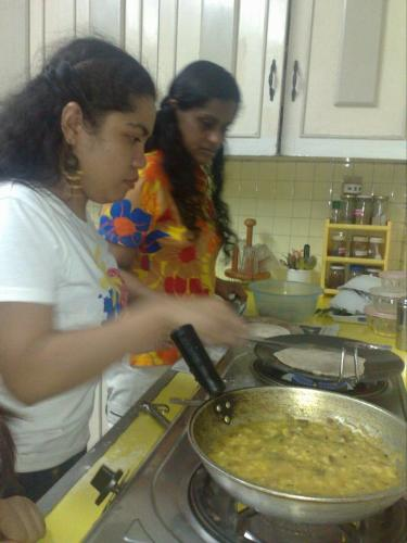 indian cooking class LOL -  trying to make chappati after I cooked the potato masala taking it seriously hahaha