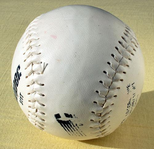 Softball - This a softball which is used in the sport.