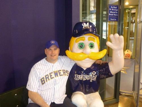 fan with Brewer Mascot - This is my friend Justin at Miller PArk posing with a statue of Bernie Brewer,the Brewers mascot.