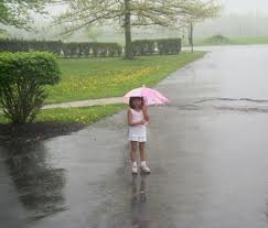 child plays in rain.. - cool rain, enjoying child with umbrella