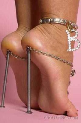 high heels - women wearing high heels, though not the most standard of high heels it does represent its discomfort properly