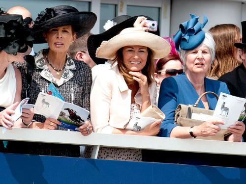 Carole Middleton - She is in the middle. She was at the Espom Derby over the weekend.