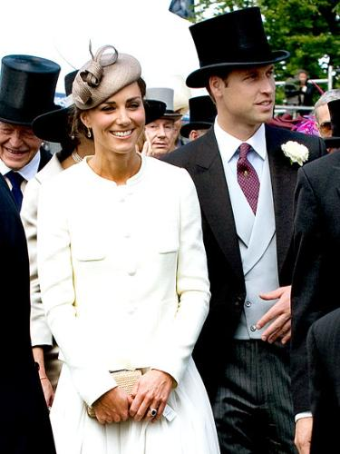 Kate and William - They were at the horse races last weekend. I like Kate's dress but didn't care for the hat! William looks ver dapper with the top hat!