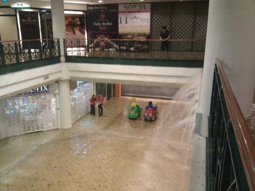 'Waterfall' at Tanglin Mall Flood - Water coming in from the streets, formed a 'waterfall' in the basement of the shopping center when sudden downpours created flash floods at the street level.