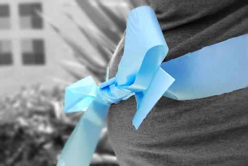 Wrapped in a blue bow - My sister in-law pregnant with her 4th and finally the boy they have desired.