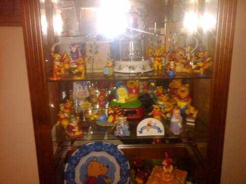 Winnie The Pooh - Here is one of my Three showcases. Each showcase is 9 feet tall.