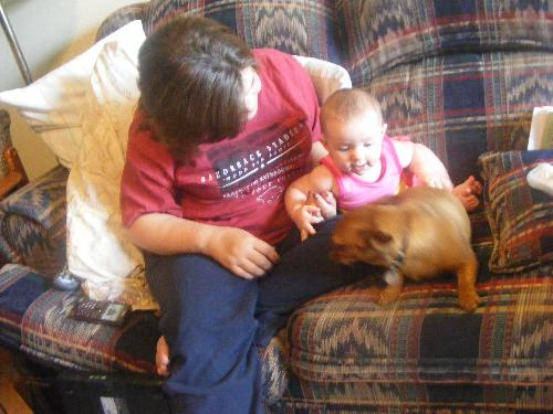 Baby girl and Emma Grace - This is my niece with our dog. Emma Loves Baby and Baby girl is So gentle with Emma. I think it's because she knows Emma drops cheerios on purpose.
