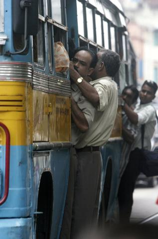 Bus Ride - Overcrowding buses is very common in Asia. This is in India.