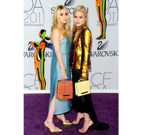 The Olsen twins - Mary-Kate and sister Ashley just turned 25. They have no sense of style in clothes and I can't belive they are clothes designers! EWW!