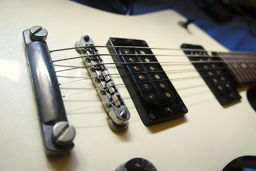guitar - A white guitar with black electronic.