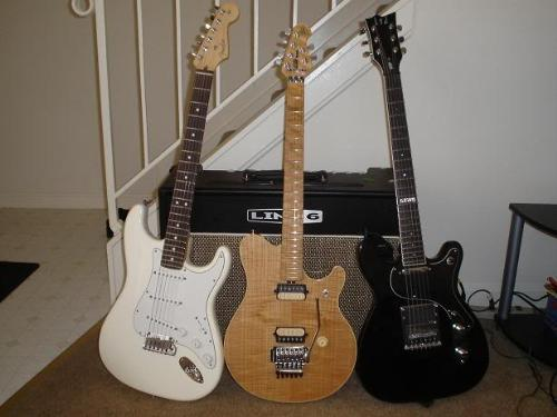 guitar - Three guitars lined up.