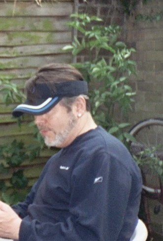 What's with the vizor? - Is this older guy trying to look 'youthful' with that jaunty vizor cap? Grow up is what I say!