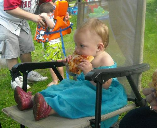 my pizza princess - my daughter in her pretty dress an eating pizza
