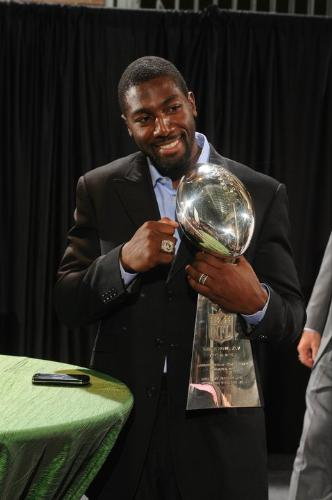 Greg Jennings - Greg Jennings of the Green Bay Packers with the Lombordi trophy and his new Super Bowl ring!