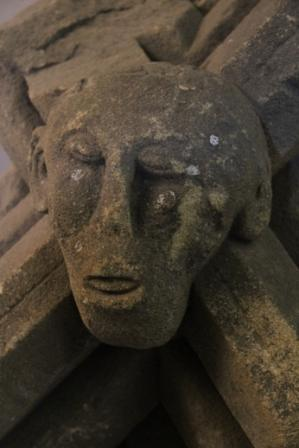 Stone head - Stone head on a church