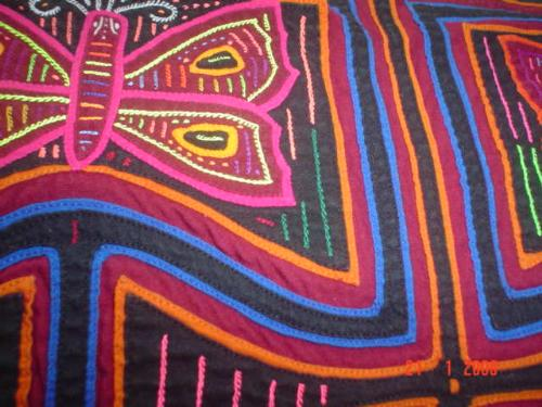 Kunayala hand work - The work is made from materials of different colours put together with small stitches.
