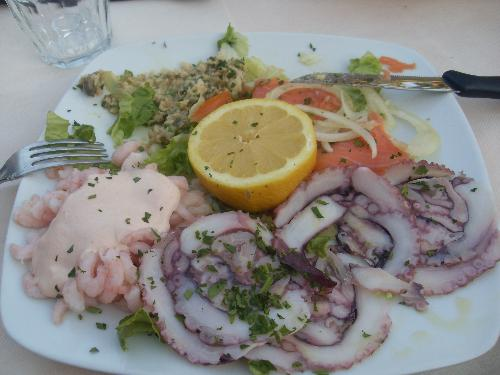 Italian Fish starter - At camping Butterfly in Peschiera Del Garda thay had a restaurant and this was our starter. It was huge and it was Delicious. Several kinds of fish, squid, Salmon, prawns. It took a while to finish. When finished we realised that we had also a main course coming which was maybe not sucha good idea since we had this big starter. It was good, please try if you are there!