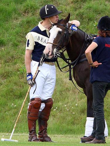 Quiet Moment - Prince William is shown here sharing a quiet moment with one of his polo ponies.
