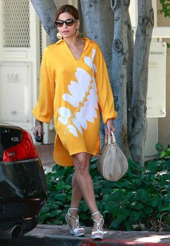 Eva Mendes - She looks like she is wearing a swimsuit coverup! Not a dress!