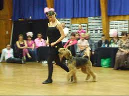 The lady who walks the dancing dog - Don't stare at the picture in vain. The girl in the picture is not inu. :))