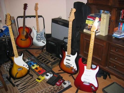 guitars - Multiple guitars in a room.