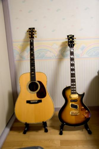 guitars - Electric and non electrical wood guitars.